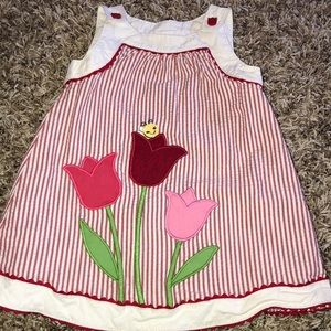 Toddlers red pin stripped dress with floral detail